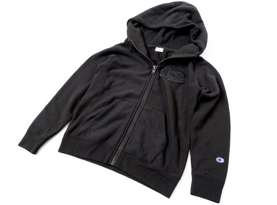 Kiks TYO once again got together with Champion to collaborate this time on a hoodie. The all black hoodie comes with an oversized Champion logo tag on the