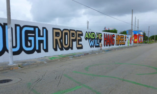 "ABOVE ""Give A Wall Street Banker Enough Rope And He Will Hang Himself"" Mural In Miami"