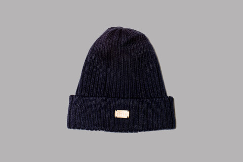 The Beanie from Han Kjobenhavn is a nice knitted beanie made from an  acrylic and wool mix. The beanie comes in a dark indigo blue color and  features a HAN ... 8f39d8385e0