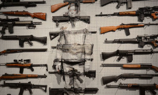"Watch ""The Invisible Man"" Liu Bolin's 'Gun Rack' Performance"