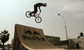 Watch Daniel Dhers Perform Incredible BMX Tricks on Two Moving Truck Trailers