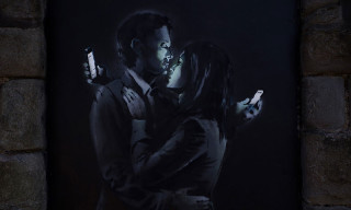 Banksy Returns with a New Street Piece Depicting Modern Love