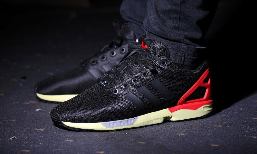 56823e59f1a83 ... adidas originals zx flux core black red highsnobiety