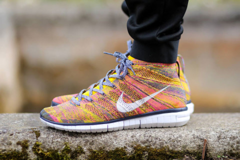 "Nike has dropped a fresh new colorway of the popular Flyknit Chukka  silhouette. A one-piece knit upper in ""Midnight Navy/White-True Yellow""  offers ..."