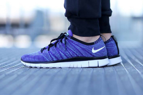"""on sale 27a80 b088a Following on the heels of the """"Pink Flash"""" rendition, Nikes Free Flyknit  NWS silhouette receives a new """"Court Purple"""" colorway."""