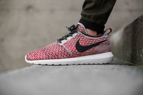 "Nike has released its Roshe Flyknit silhouette in a new summer-ready  ""Bright Crimson Anthracite"" colorway. Combining Nike innovations with  minimal design a3e1d3660254"