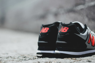 black and orange new balance 574