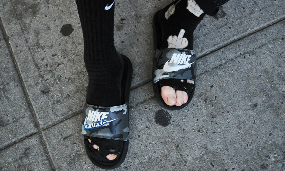 Jenkem Skates New York In A Pair Of Nike Slides