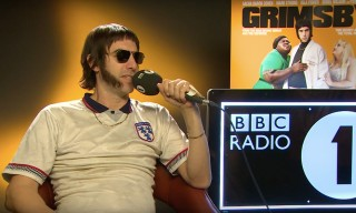 Sacha Baron Cohen Appears as Brother Grimsby in BBC Radio 1 Interview