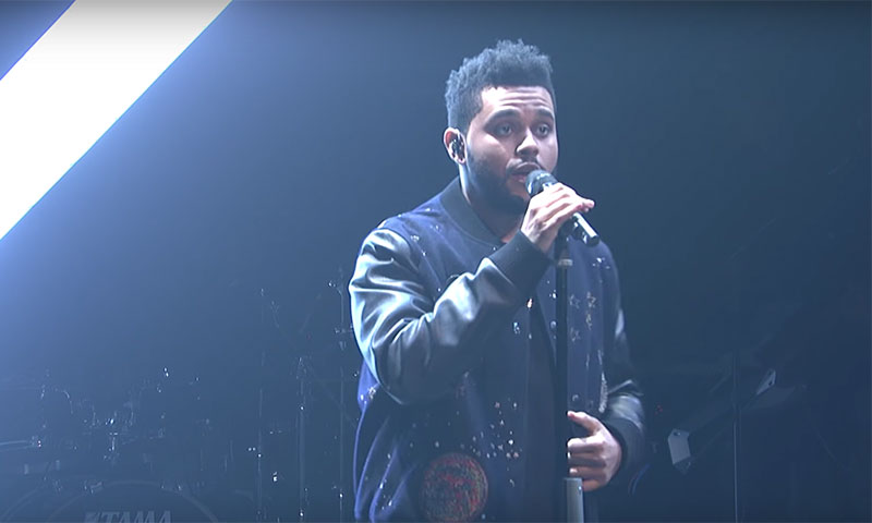 watch the weeknd perform starboy and false alarm on