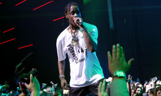 Travis Scott Performs in a PSG x Jordan Basketball Jersey