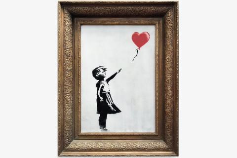 Banksy shocks art world by shredding $1.4 mln work at auction