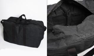 Nom De Guerre Coated Canvas Duffel Bag