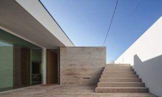 The Glass & Concrete L-Shaped Milhundos House Located in Portugal